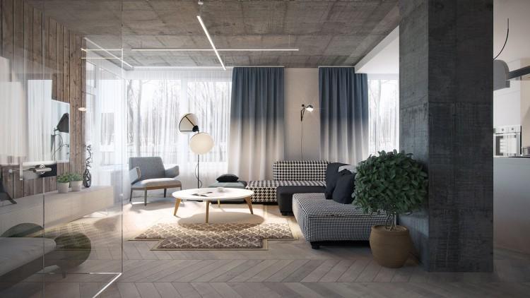 Salon avec un canapé noir et blanc