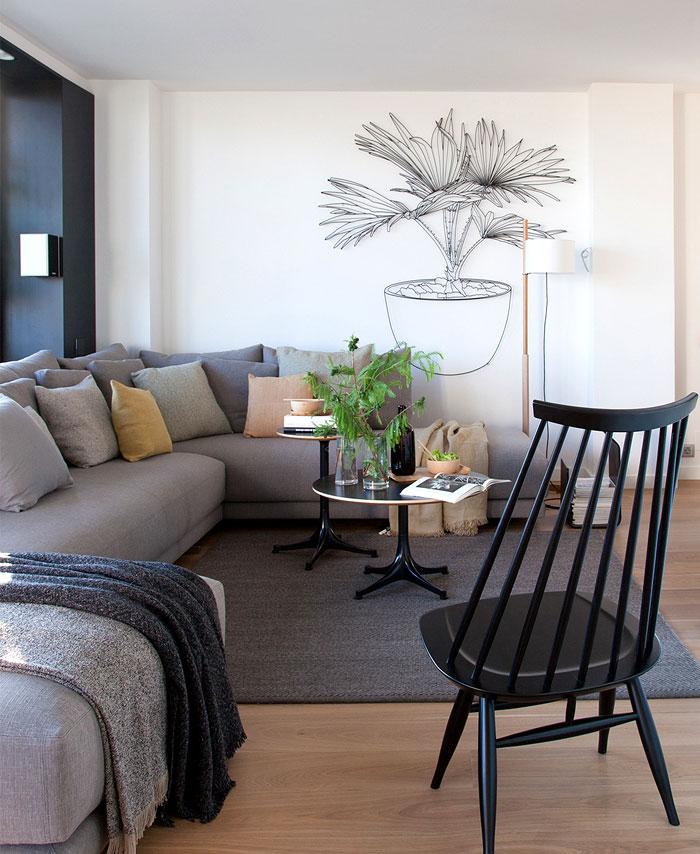 Décoration d'un salon avec un canapé  d'angle